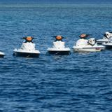 Jet skis moored in a line