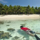Man snorkeling off a tropical island