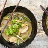 Bowls of Thai green curry with chopsticks
