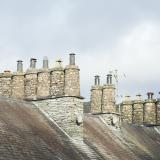 Traditional cylindrical stone chimney pots