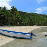 Wooden boat on a tropical island