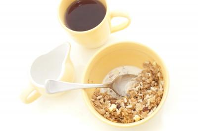 Bowl of muesli and coffee for breakfast
