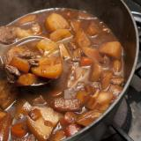 Delicious beef stew cooking in a pot